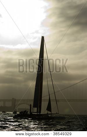 SAN FRANCISCO, CA - OCTOBER 4: Italy's Luna Rossa Swordfish sails near the Golden Gate Bridge in the America'??s Cup World Series sailing races in San Francisco, CA on October 4, 2012