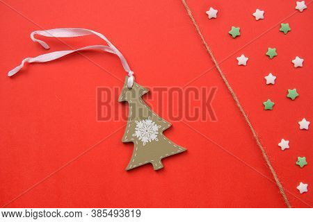 Christmas Decorations Decorative Background. Pins In The Form Of Red Gloves And Wooden Christmas Tre