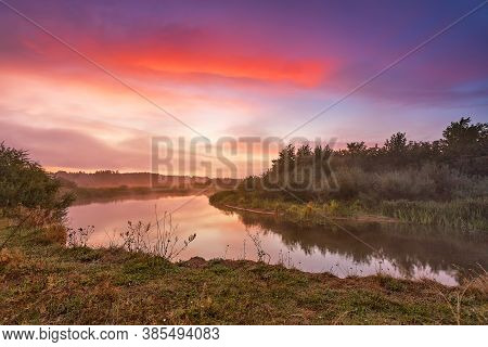 River Misty Autumn Sunrise. Colorful Dawn. Cloudy Sunrise. Dusk Fall Colors