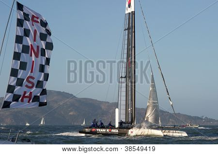 SAN FRANCISCO, CA - OCTOBER 4: Team Korea skippered by Peter Burling crosses the finish line in the America'??s Cup World Series sailing races in San Francisco, CA on October 4, 2012