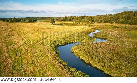 Agriculture Fields After Harvest, Sunny September Day. Autumn Landscape In Evening Sunlight From Abo