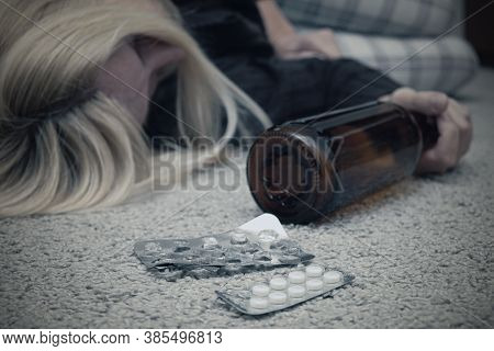 A Woman Committed Suicide By Overdosing And Died On The Floor With Empty Blister Of Pills And A Bott