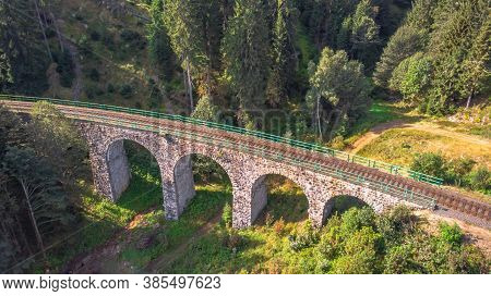 Aerial Top View Of Stone Railway Viaduct In A Small Village Of Pernink, Czech Republic. Old Czech Ra