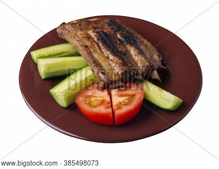 Grilled Pork Ribs With Sliced Cucumbers And Tomatoes On Brown Plate. Pork Ribs Isolated On White Bac