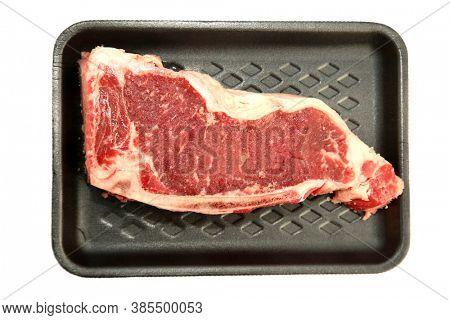New York Strip Steak. Raw New York Strip Steak on a black foam tray. Steak is loved by people world wide.