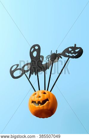Halloween Decorations. Bottom View Halloween Party Accessories And Jack-o-lantern Pumpkin On Pastel