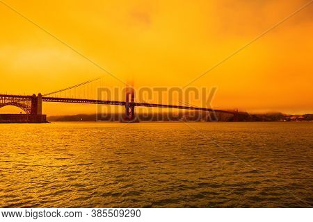 Wildfires Smoky Orange Sky On Golden Gate Bridge Of San Francisco Skyline From Fort Point. Californi