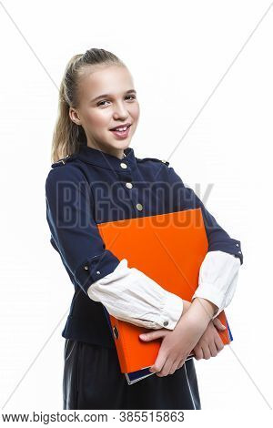 Portrait Of Smiling Caucasian Teenager Girl Posing With Batch Of Office Folders Against White Backgr