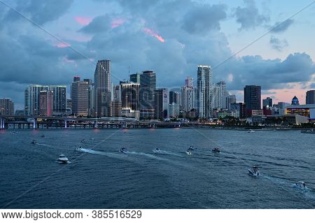 Miami, Florida - July 4, 2019 - Boats Gather In Front Of City Of Miami Skyline At Dusk Ahead Of Inde