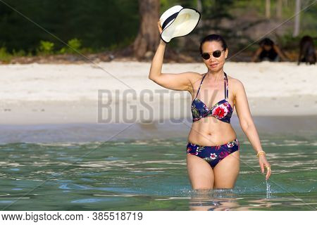 Woman Pretty In Bikini Smile With Sunlight At Beach Koh Chang Thailand. Koh Chang Is Located In The
