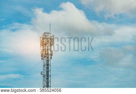 Telecommunication Tower With Blue Sky And Clouds. Antenna. Radio And Satellite Pole. Communication T