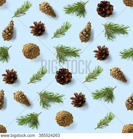 Seamless Christmas Pattern From Pine Cones On Blue Background. Modern Pine Cone Christmas Collage. P