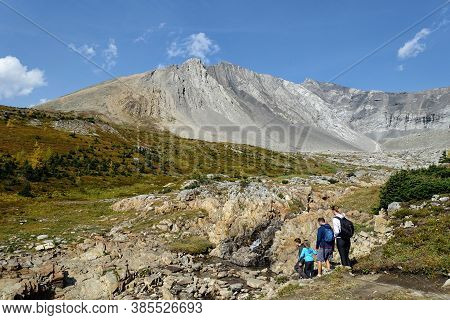 Kananaskis, Alberta, Canada - September 12th, 2020: A Young Family Going For A Hike In The Mountains