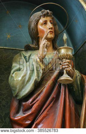 SVETI IVAN ZELINA, CROATIA - JUNE 26, 2013: Saint John the Evangelist statue on the altar at Our Lady of Sorrows parish church of Saint John the Baptist in Sveti Ivan Zelina, Croatia
