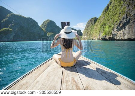 View Of Woman In Swimsuit Enjoying On Thai Traditional Longtail Boat Over Beautiful Mountain And Oce