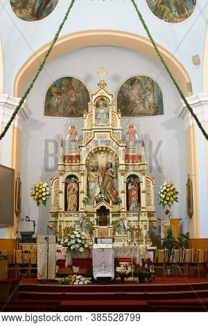 SVETI IVAN ZELINA, CROATIA - JUNE 26, 2013: High altar in the parish church of Saint John the Baptist in Sveti Ivan Zelina, Croatia