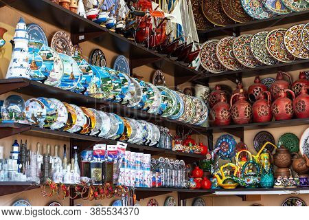 Souvenir Shops On The Sevastopol Embankment On August 13, 2020. Bright Painted Plates And Vases. Col