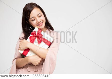 Happy Beautiful Asian Woman Smile And Hugging Gift Box Isolated On White Background. Teenage Girls I
