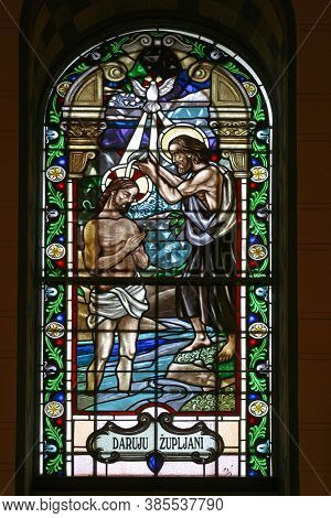 OROSLAVLJE, CROATIA - MAY 27, 2013: Baptism of the Lord, stained glass in the parish church of the Assumption of the Virgin Mary in Oroslavlje, Croatia
