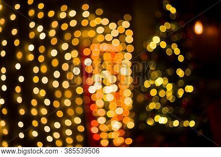 Christmas Home Room With Tree And Festive Bokeh Lighting, Blurred Holiday Background. Template