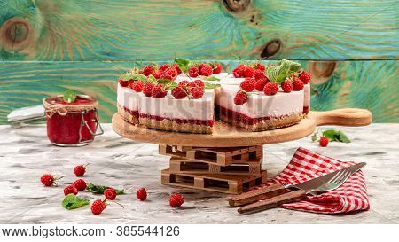 Homemade Cheesecake With Fresh Raspberries And Mint For Dessert, Delicious Cheesecake With Berries,
