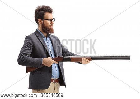 Bearded man aiming with a shotgun isolated on white background
