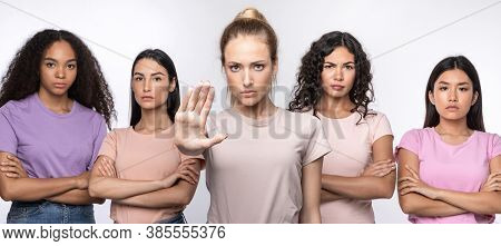 Discontented Multiethnic Ladies Gesturing Stop Standing Together Over White Studio Background. Forbi