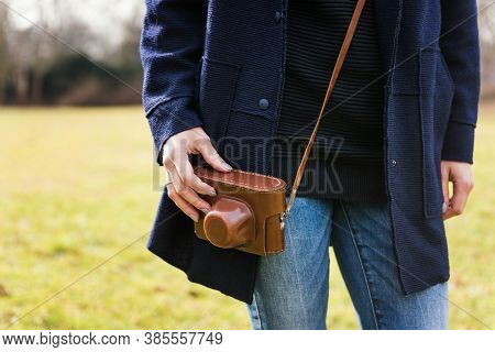 Close Up Of Young Woman Hipster Holding Retro Film Camera In Hands. Woman's Hands Holding An Old Ret