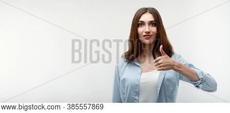 Caucasian Young Female With Long Chestnut Hair, Dressed In Casual Clothes, Shows Okay Sign With Both