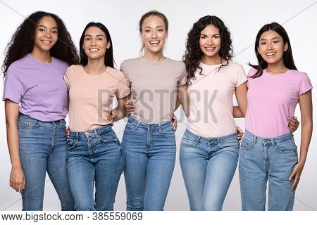 Group Of Five Cheerful Multicultural Ladies Embracing Posing Standing Over White Background, Smiling