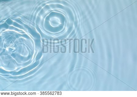 Blurred Transparent Blue Colored Clear Calm Water Surface Texture With Splashes And Bubbles. Trendy
