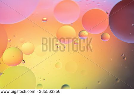 Oil Drops In Water. Abstract Defocused Psychedelic Pattern Image Rainbow Colored. Abstract Backgroun