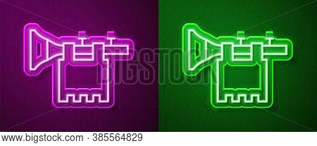 Glowing Neon Line Trumpet With Flag Icon Isolated On Purple And Green Background. Musical Instrument
