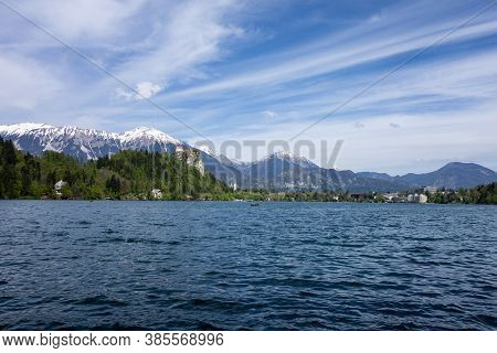 Bled Lake With The Bled Castle In Slovenia, Europe In The Background With Blue Sky