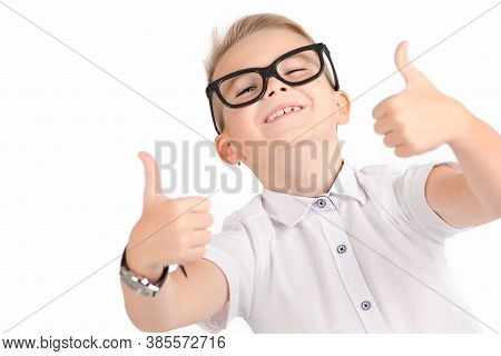 Portrait Of Atractive Elementary School Student Showing His Thumbs Up On Isolated White Background.