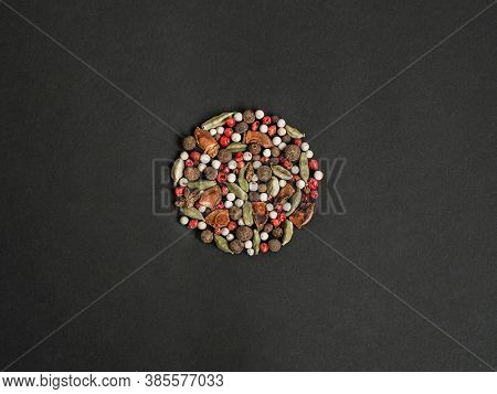 Various Dry Spices - Star Anise, Cardamom, Allspice, Pink And White Peppercorns Collected In A Patte