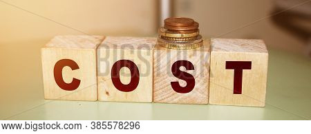 Cost Word On Wooden Cubes. Business Expense, Company Profit Loss Concept,