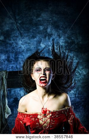 Portrait of a bloodthirsty female vampire.
