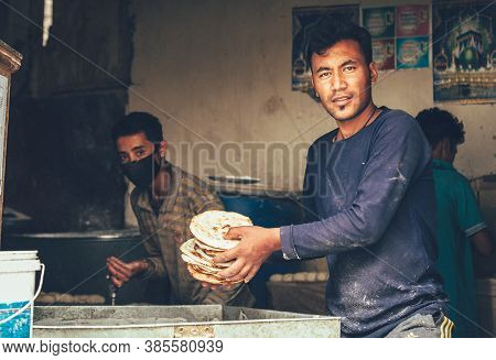 Leh , Ladakh Region , India - August 20, 2016: Chapati Baker Preparing The Fresh Flatbread On The St