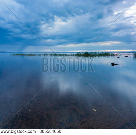 Blue Dramatic Minimalist Landscape With Smooth Surface Of The Lake With Calm Water With Horizon Unde