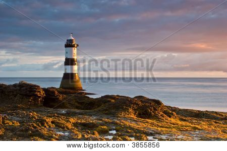 Lighthouse At Sunrise