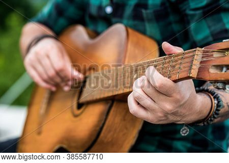 Acoustic Guitars Playing. Music Concept. Guitars Acoustic. Live Music. Music Festival. Male Musician