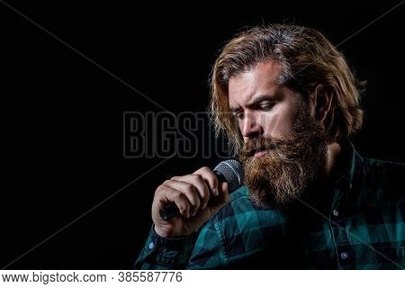Man Singing With Microphone. Male Singing With A Microphones. Bearded Man In Karaoke Sings A Song In