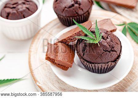 Marijuana Chocolate Cupcake Muffins With Weed Cbd. Medical Marijuana Hemp Drugs In Food Dessert. Wee
