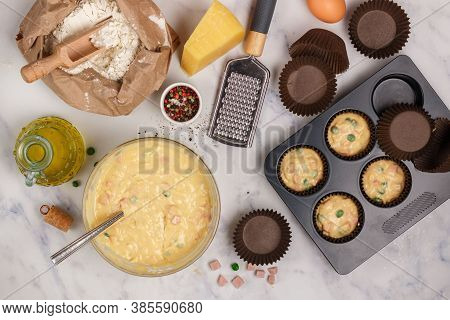 Preparation Homemade Savory Muffins With Parmesan Cheese, Sausage Or Ham And Green Peas For Breakfas