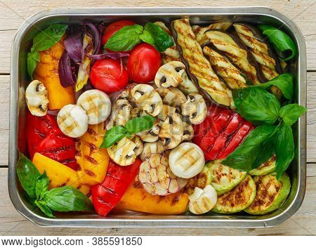Grilled Fresh Vegetables - Red And Yellow Bell Peppers, Purple Onions, Tomatoes, Garlic, Eggplants,