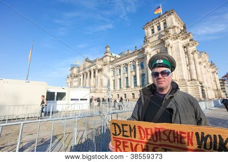 BERLIN - NOVEMBER 3: Protester in front of the Bundestag on November 3, 2011 in Berlin, Germany. Citizens are becoming more disillusioned with the current political system.