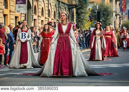 ALBA, ITALY - OCTOBER 06, 2019: Participants in historic dresses on Medieval Parade - traditional celebrations during annual White Truffle festival taking place each year in Alba, Northern Italy.