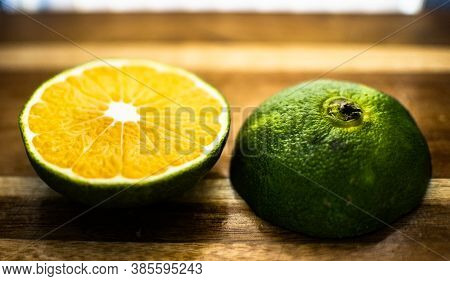 Bergamot Oranges On Wooden Background Lined Up In A Stacked Order.