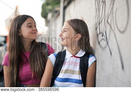 two young girls laugh at each other